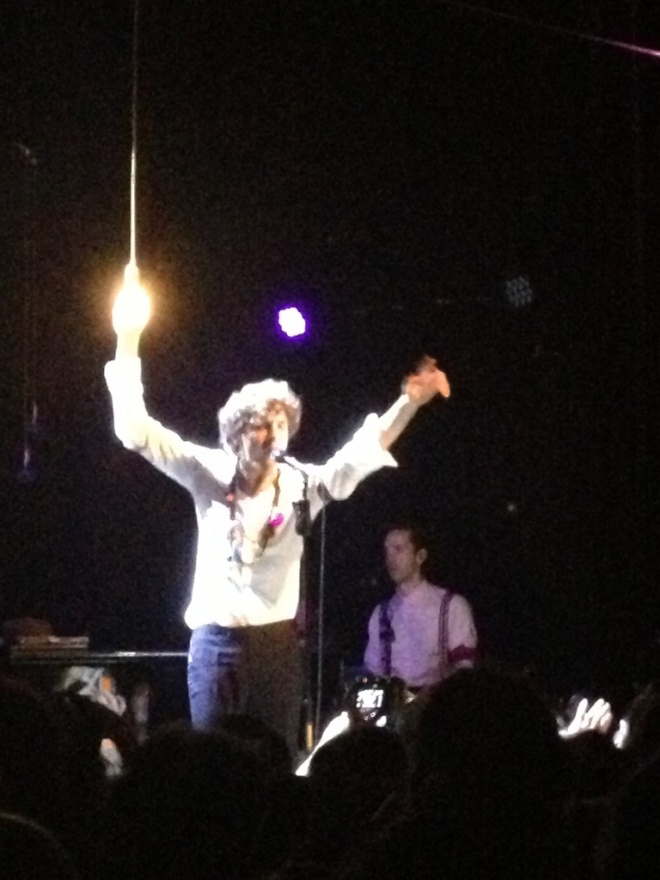Mika holds the lightbulb tragically